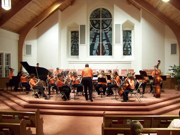 conducting the youth orchestra